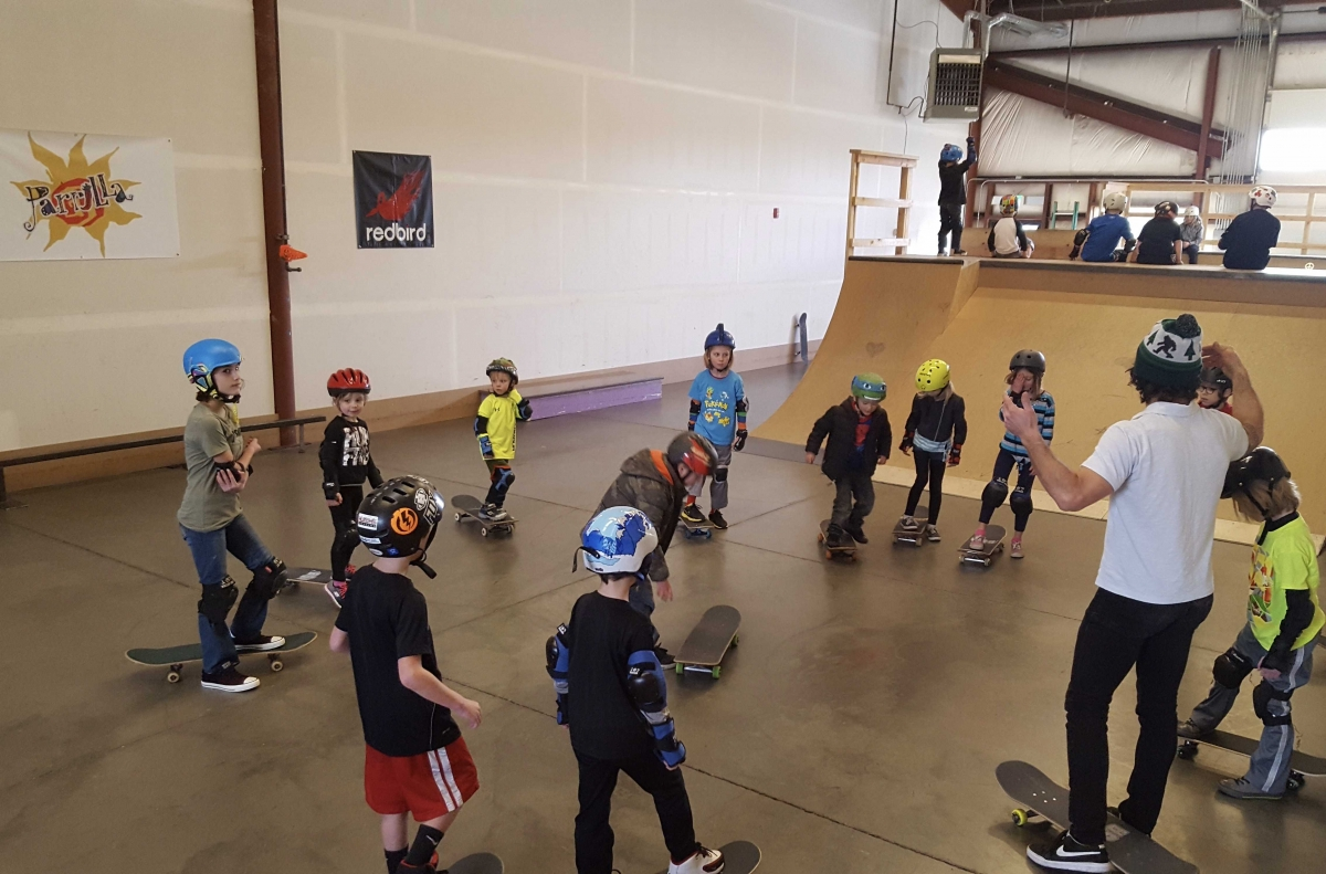 Coach Gabe dropping knowledge on Skateboard Skills Campers.